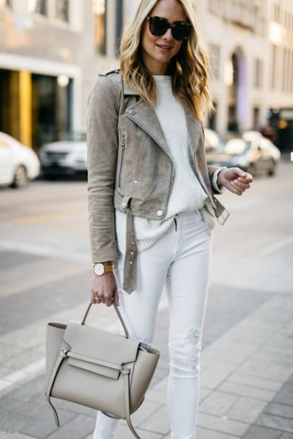 With white sweater, white pants and gray leather bag