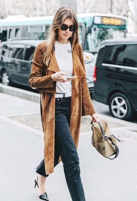 With white t shirt, loose jeans, beige bag and patent leather shoes