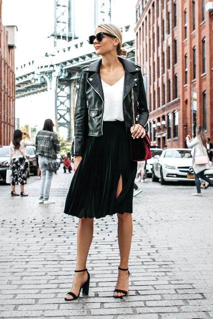 With white top, black velvet skirt, black leather jacket and black high heels