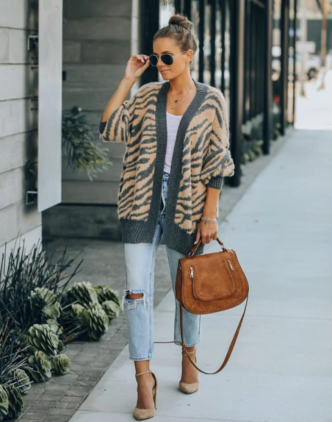 With white top, light blue crop jeans, brown bag and beige high heels