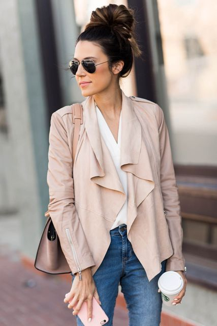 With white wrap shirt, jeans and pastel colored bag