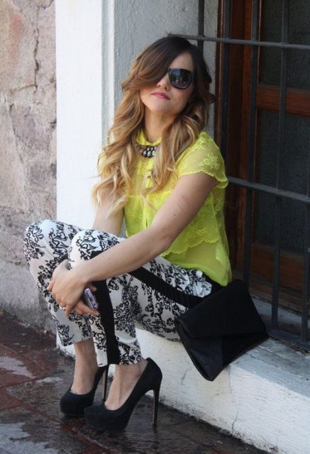 With yellow lace blouse, black clutch and black high heels