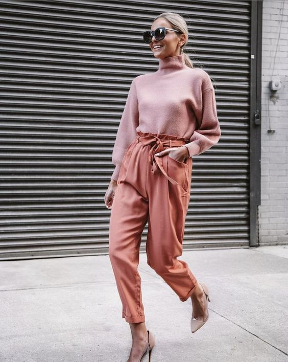 a beautiful look with a pale pink turtleneck, muted rust-colored pants, nude shoes for spring