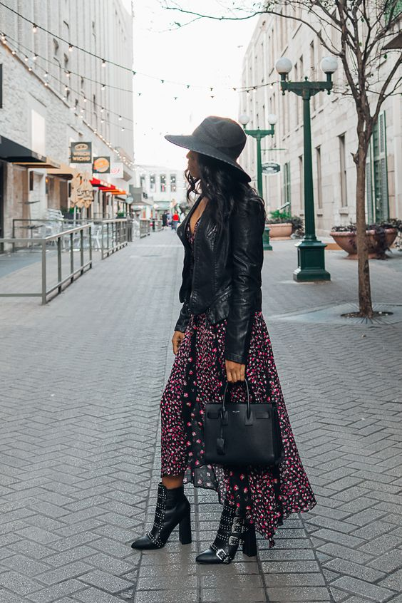 a black and pink midi floral dress, a black leather jacket, black grunge boots, a black hat and bag