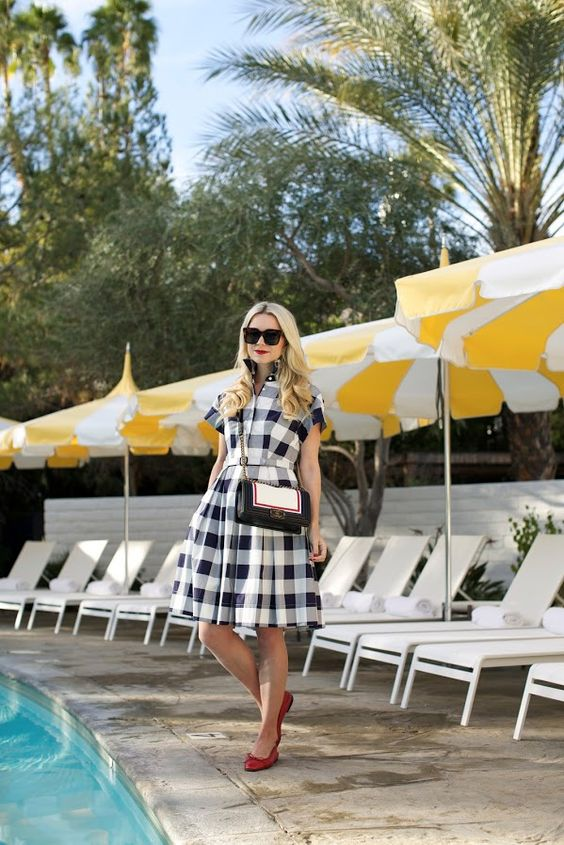 a black and white check A-line knee shirtdress with red flats and a black and white bag for a vintage feel