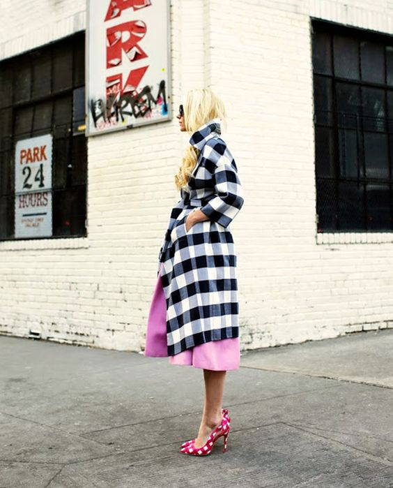 a black and white check coat over a pink dress, pink checked shoes for a bold and fun look with plenty of prints