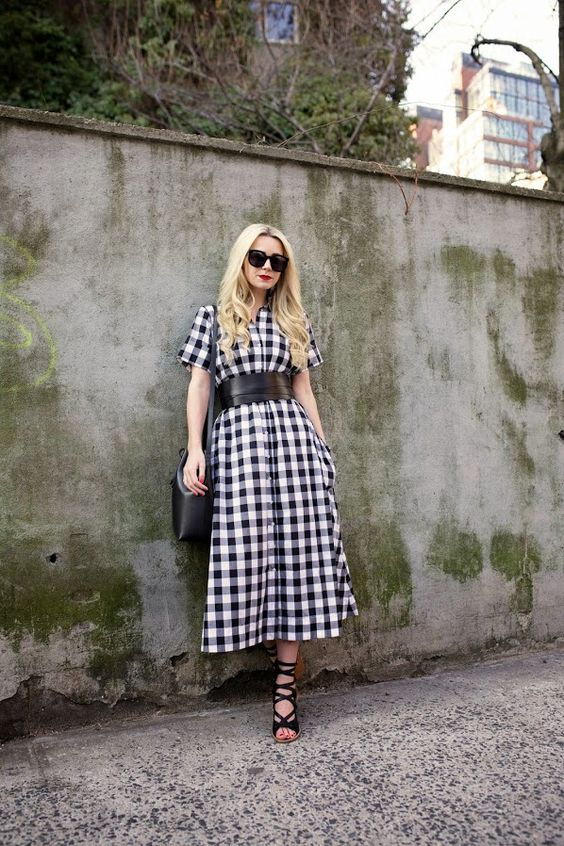a black and white check midi shirtdress, a wide leather belt, black lace up shoes and a black bag