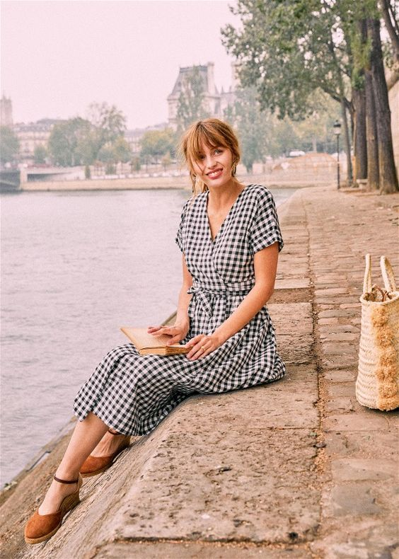 a black and white check wrap midi dress, espadrilles and a woven bag for a lovely Parisian look