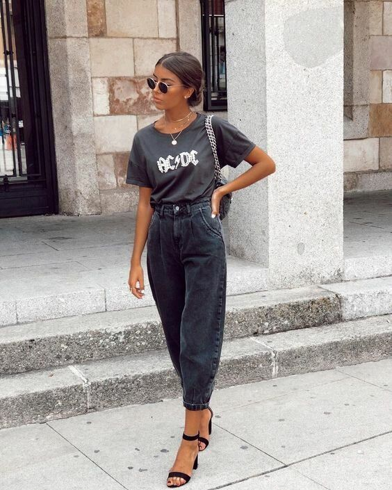a black printed tee, black barrel jeans, black heels and a black bag on chain to add a rock feel