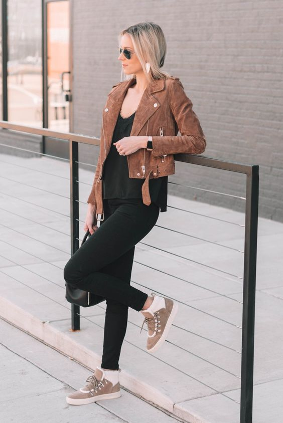 a black top, skinnies, a cropped brown suede jacket, tan sneakers and white socks