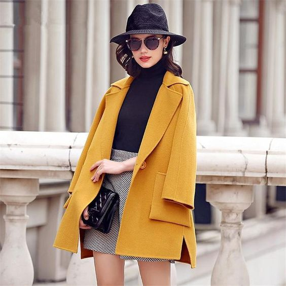 a black turtleneck, a grey gingham mini, a yellow coat, a black hat and a black bag for a chic look