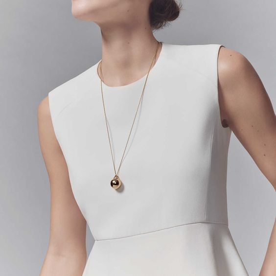 a bold and super modern gold necklace with a sphere is a perfect solution to make your look ultimate