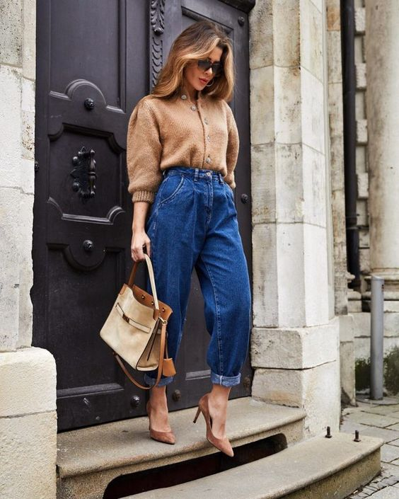 a camel cardigan as a shirt, bold blue barrel jeans, beige shoes and a neutral bag for a cozy and cool look