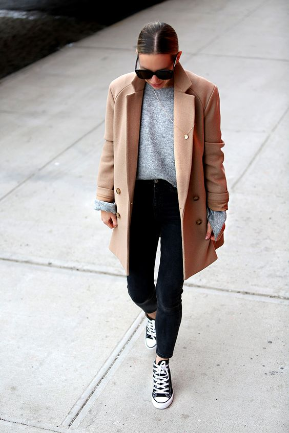 a casual trasitional look with a grey sweater, an oversized camel blazer, black skinnies and black sneakers