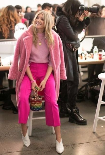 a chic look with a pink jumper, hot pink cropped pants, a pink faux fur coat, white shoes and a colorful basket