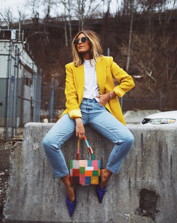 a colorful look with a white tee, blue jeans, bold blue shoes, a colorful bead bag and a lemon yellow blazer