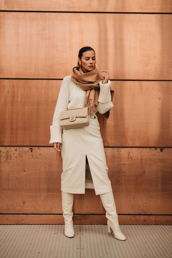a creamy winter look with a chunky knit sweater, a midi pencil skirt, boots, a beige bag and a camel scarf