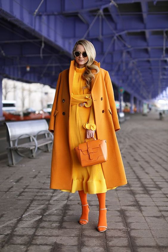 a gold look with a yellow midi dress, marygold tights and a gold coat, nude shoes and a marygold bag