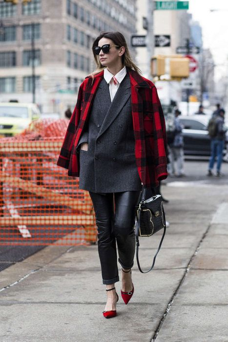 a gorgeous work outfit with black leather trousers, a white shirt, a black oversized blazer, red shoes and a red plaid coat
