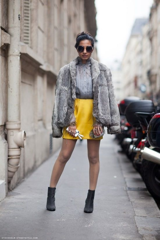a grey blouse, a lemon yellow mini, black boots, a grey faux fur jacket for a cold day