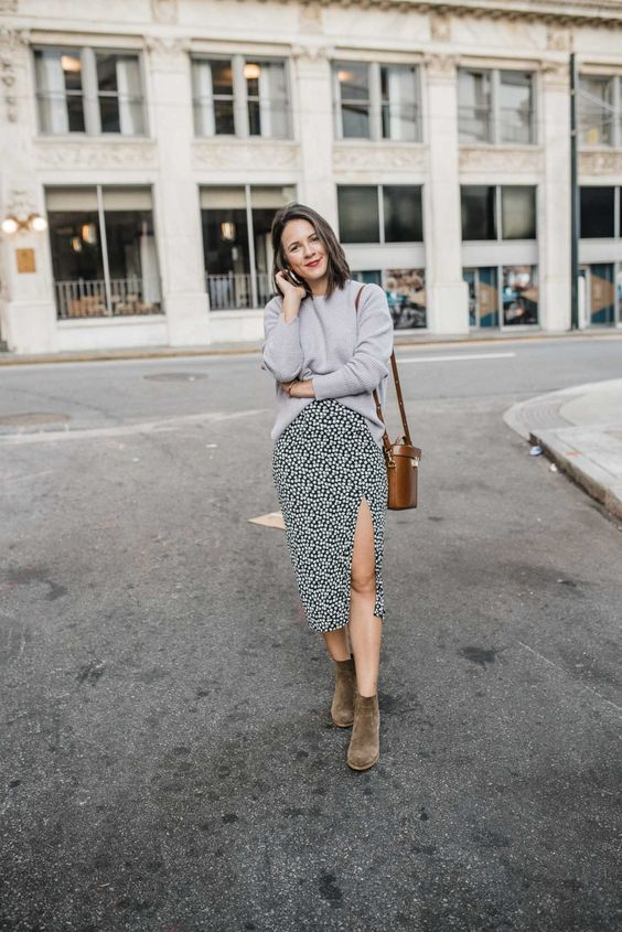 a grey jumper, a printed black and white midi with a slit, taupe velvet boots and a bucket bag