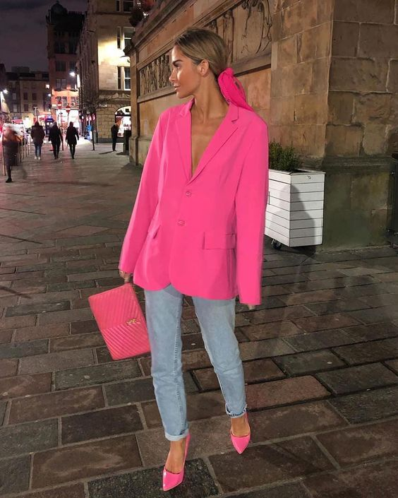 a hot pink oversized blazer, light blue jeans, hot pink shoes and a clutch for a color statement