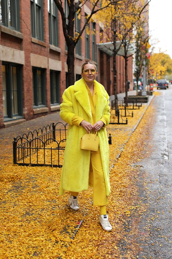 a lemon yellow look with a pantsuit, socks, a faux fur coat, a mini bag and trainers