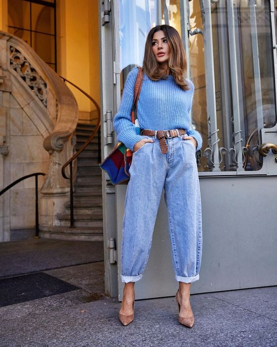 a light blue sweater, blue barrel jeans, nude shoes and a color block bag for a lovely look