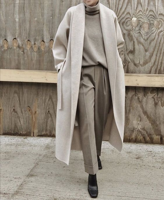 a minimalist grey look with a turtleneck, trousers, black square toe boots, a light dove grey coat