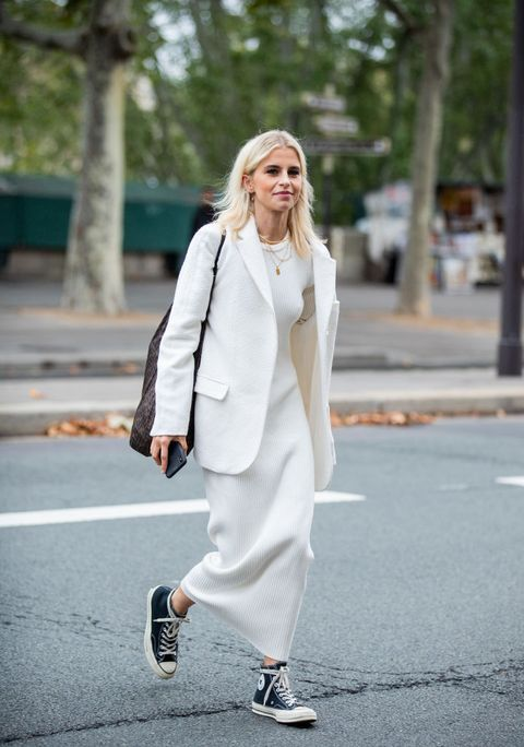 a minimalist white maxi dress, an oversized white blazer, a brown tote and black sneakers