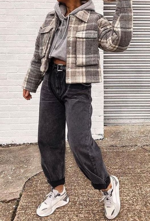 a monochromatic look with a grey cropped hoodie, black jeans, contrasting trainers, a plaid cropped jacket