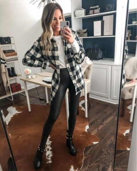 a monochromatic outfit wiht a white tee, black leggings, a check shirt, black boots and layered necklaces