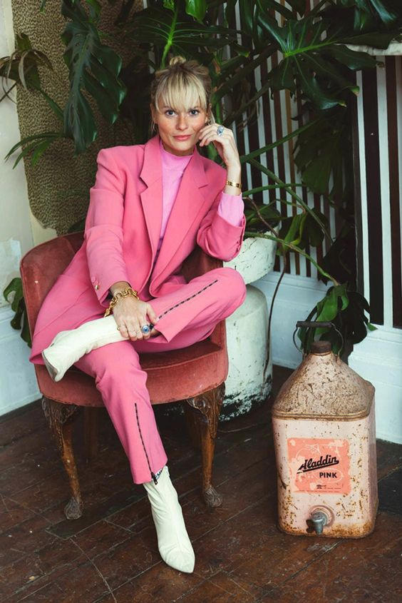 a pink pantsuit, a neon pink turtleneck, white boots for a bold work look this spring