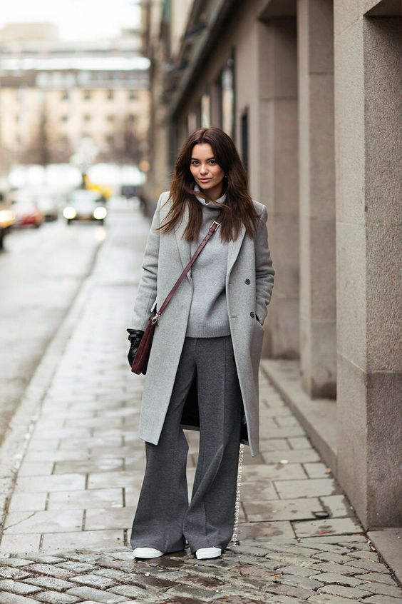 a relaxed outfit with a turtleneck, graphite grey pants, a grey coat, a burgundy bag and white sneakers
