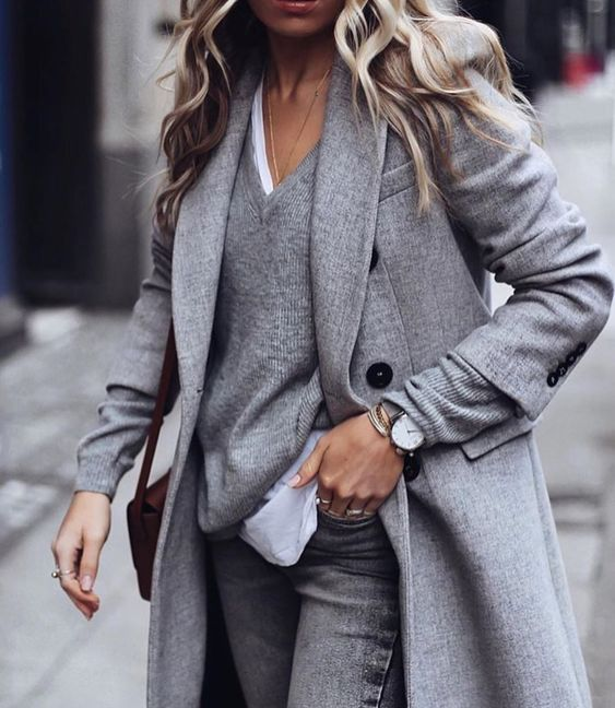 a relaxed outfit with a white tee, a grey jumper, grey skinnies, a coat is always a good idea