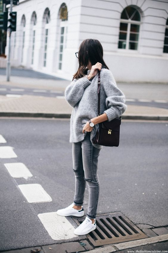 a simple and casual look with an oversized grey sweater, skinnies, white sneakers, a black bag is cool