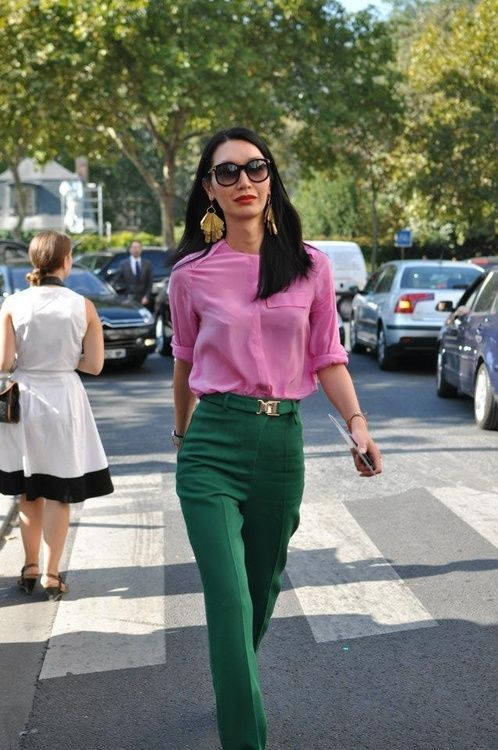 a statement color block look with a pink shirt and emerald green trousers plus statement earrings