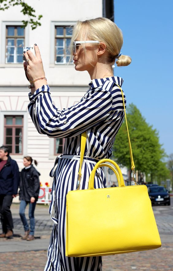 a striped navy and white shirtdress, a lemon yellow bag for a contrast will compose a cool summer look