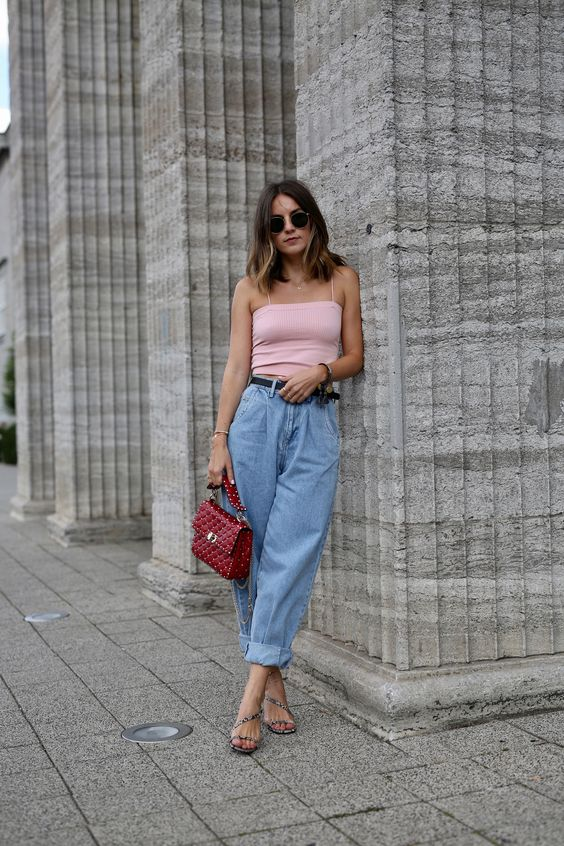 a summer look with a pink crop top, blue barrel jeans, embellished heels, a red bag is a stylish outfit