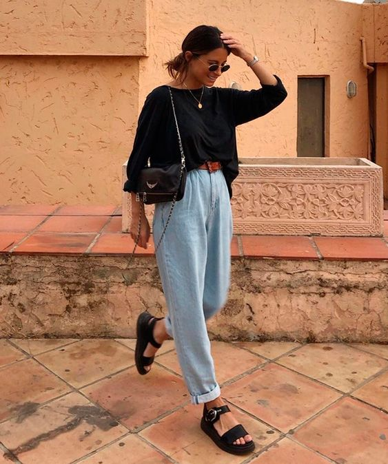 a summer outfit with a black top, whitewashed barrel jeans, black platform shoes and a black bag