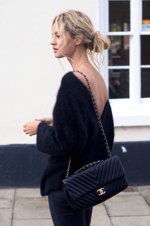 a hot total black outfit with an open back