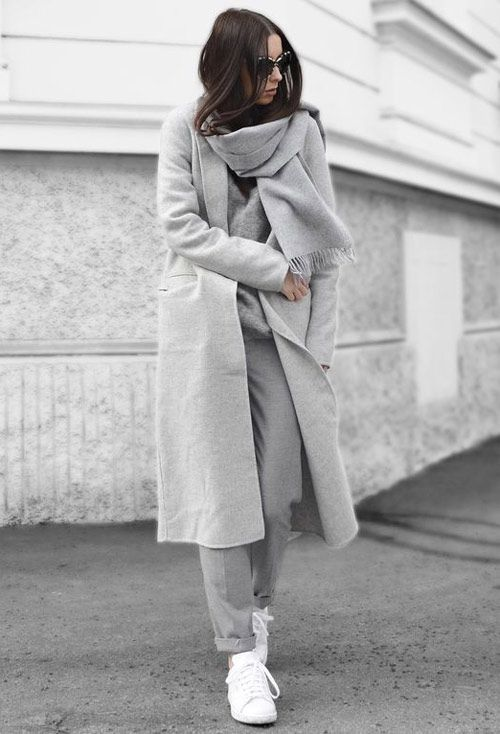 a total grey look with a sweater, trousers, a scarf, a midi coat and white sneakers is timeless classics