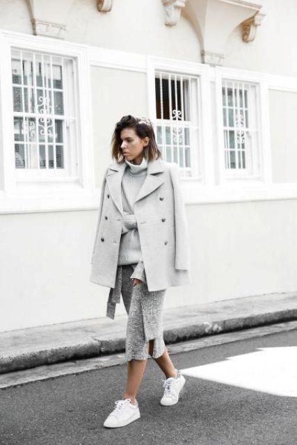 a very light grey sweater over a sweaterdress, a light grey short coat, white sneakers