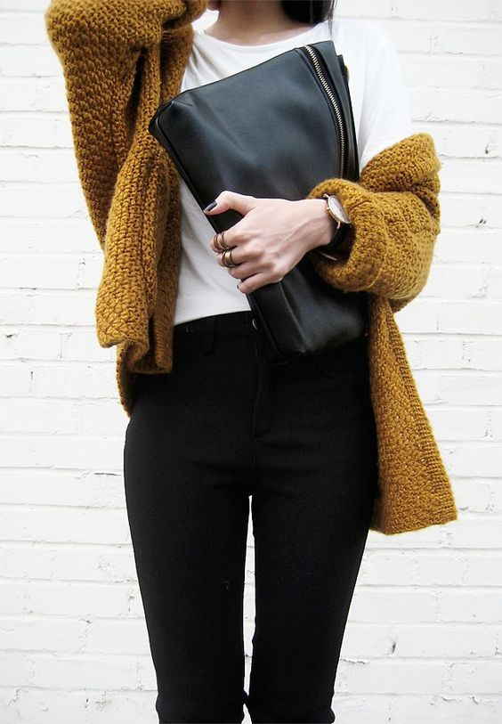 a very simple look with a white tee, black jeans, a mustard chunky knit cardigan and a black bag