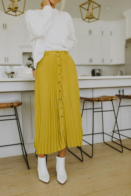 a white jumper, a mustard pleated button up midi skirt, white booties for a lovely and bold look