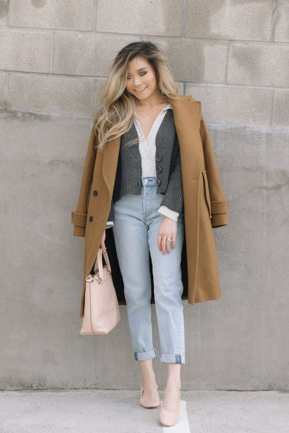 a white shirt, a grey cropped cardigan, a camel coat, light blue jeans, blush flats and a matching bag