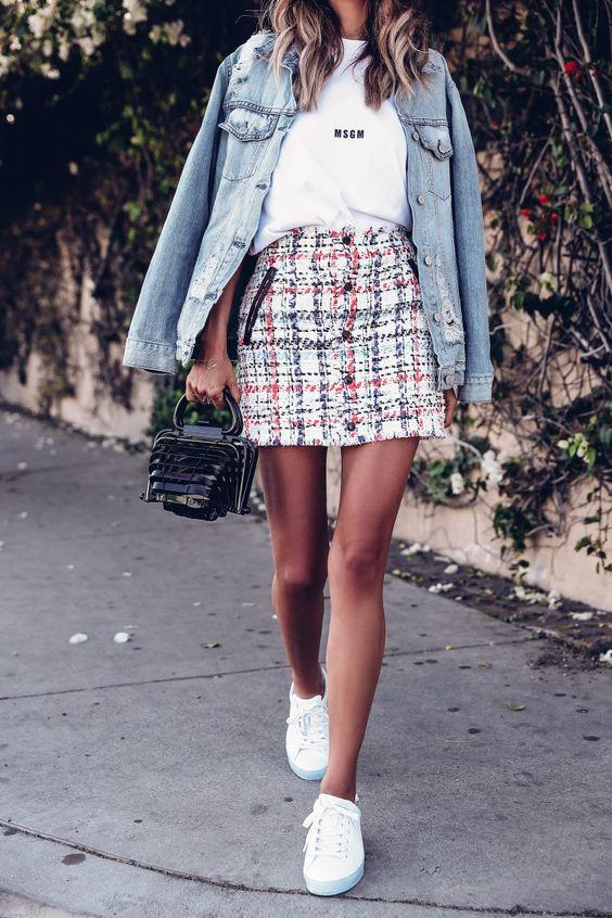 a white t shirt, a tweed mini skirt, a light blue denim jacket, white platform sneakers and a black bag