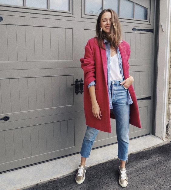a white tee, a blue striped shirt, blue jeans, silver sneakers, a pink coat for a fun and cool look