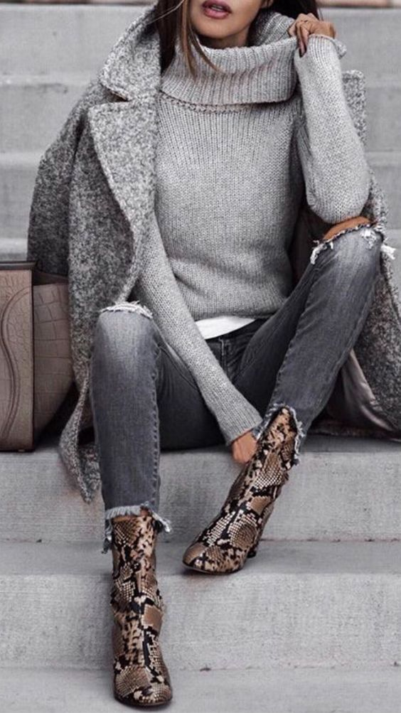 a white tee, a grey turtleneck sweater, ripped skinnies, a grey coat and snakeskin boots