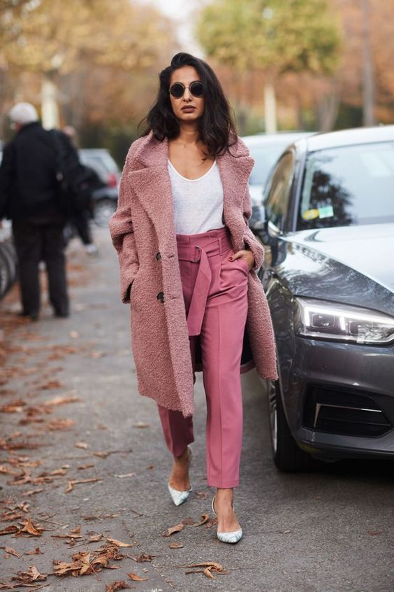 a white top, pink trousers, floral shoes and a pink fuzzy coat for winter to spring time
